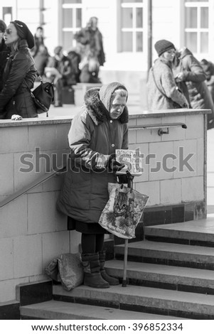 MOSCOW, RUSSIAN FEDERATION - MARCH 26: Beggar woman begging in the alley, on March 26, 2016 in Klimentovsky alley, Moscow, Russia .