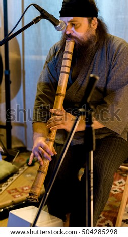 "MOSCOW, RUSSIAN FEDERATION - OCTOBER 22, 2016: Sui zen meditation and concert of traditional Japanese bamboo flute (syakuhati) music in the culture center ""O"".  Small Nikolopeskovskiy Lane."
