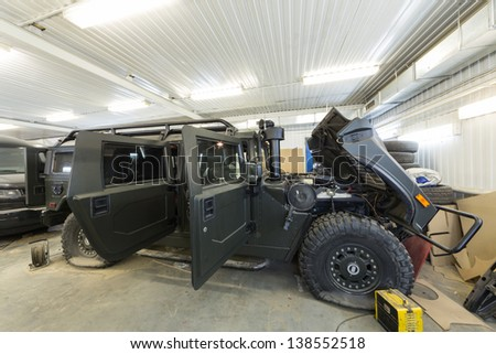 MOSCOW - SEP 21: Large military car is in the repair on car repair shop Avtostandart on September 21, 2012 in Moscow, Russia. - stock photo