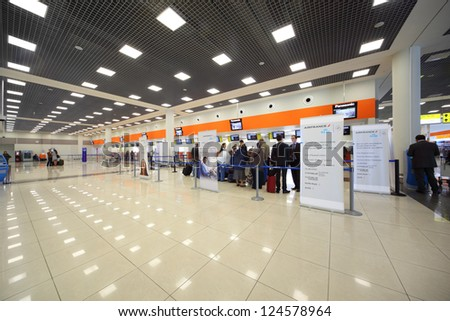 MOSCOW - SEP 22: Passengers in Sheremetyevo airport on Sep 22, 2011 in Moscow, Russia. In Moscow airports in 2013 will be implemented automated monitoring system to check biometric passports. - stock photo