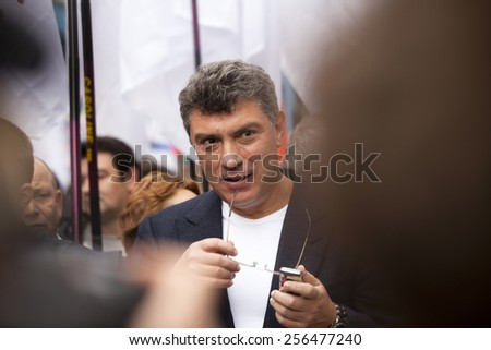 MOSCOW - SEP 15: Russian opposition leader Boris Nemtsov at march of millions protest through Moscow on SEP 15, 2012 in Moscow,Russia - stock photo