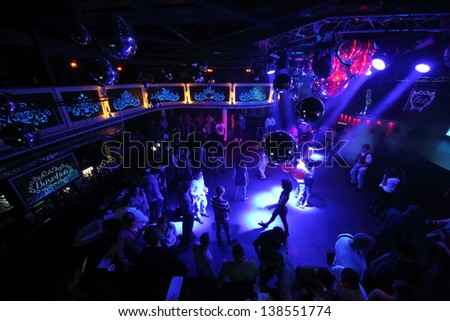 MOSCOW - SEP 21: The people on the dance floor of the nightclub Base on September 21, 2012 in Moscow, Russia.