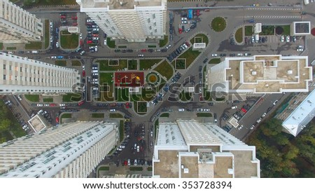 MOSCOW - SEP 04, 2015: Yard with cars and playground near dwelling complex on Elk Island at autumn evening. Aerial view - stock photo
