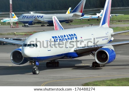 MOSCOW - SEPTEMBER 05: Airplane in airport Domodedovo in September 05, 2012 in Moscow. The airplane Boeing 777-200ER of Transaero airlines Reg EI-UNT  - stock photo
