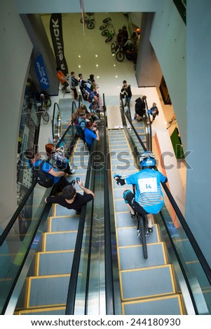 MOSCOW � SEPTEMBER 13: biker on mountain bike riding down the stairs at DownMall contest, September 13, 2014 in Moscow, Russia - stock photo