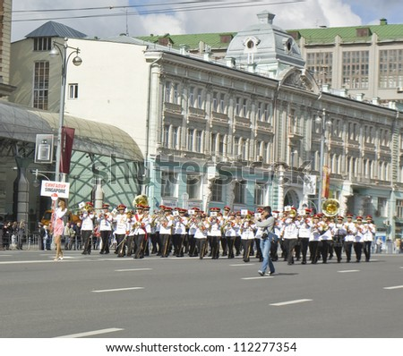 "MOSCOW - SEPTEMBER 01: international festival of military orchestras ""Spasskaya tower"", orchestra from Singapure on parade go by Tverskaya street to Red square, September 01, 2012, in Moscow, Russia."