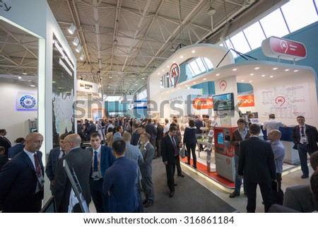 MOSCOW - SEPTEMBER, 02: People attend V Anniversary International Railway Show Engineering and Technology EXPO 1520 on September 02, 2015 in Moscow - stock photo