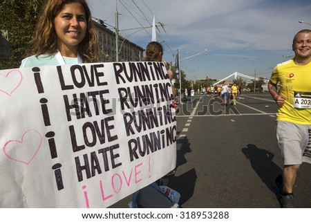 MOSCOW, 20 SEPTEMBER, 2015: People support runners on a finish of the Moscow marathon near the sports complex Luzhniki