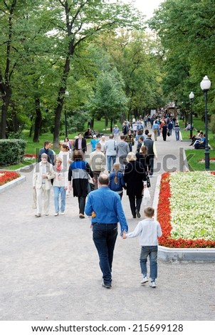 MOSCOW - SEPTEMBER 06, 2014: People walk on Gogol boulevard decorated by flowers. Moscow City Day celebration in Moscow city center.