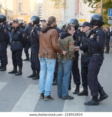 MOSCOW - SEPTEMBER, 21:  Police on manifestation of muscovites against war in Ukraine and Russia's support of separatism in this country, Circular Boulevards in Moscow, Russia on September, 21, 2014.