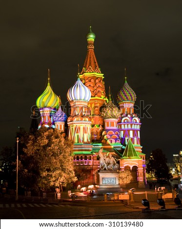 "MOSCOW - SEPTEMBER 03, 2014: St. Basils Intercession cathedral illuminated for festival ""Spasskaya tower"", has been built in 1552 year. - stock photo"