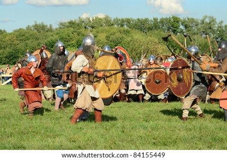 "MOSCOW - SEPTEMBER 4: Two unidentified warriors compete in the middle of a big battle reconstruction at the international festival of fights ""Times and Epoch"" on September 4, 2011 in Moscow, Russia. The event's attendance is about 130,000 people."