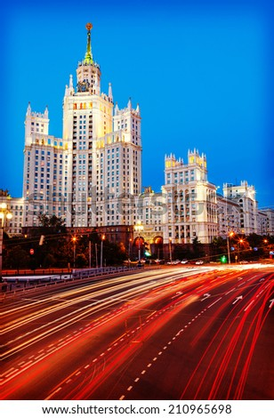 Moscow, Stalin skyscraper and road traffic on the embankment of the Moscow  River and Yauza river and road traffic in the evening - stock photo