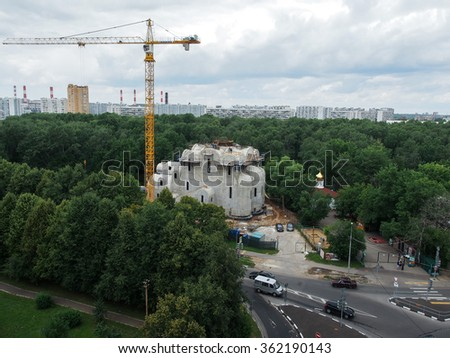 Moscow - Summer 2015: Dmitrov District, Street Sofia Kovalevskaya, the construction of an Orthodox church. Russia Moscow. The temple is built, the builders work. We see houses
