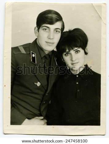 MOSCOW, USSR - CIRCA 1980s : An antique photo shows studio portrait of a mature man and a woman - a married couple.