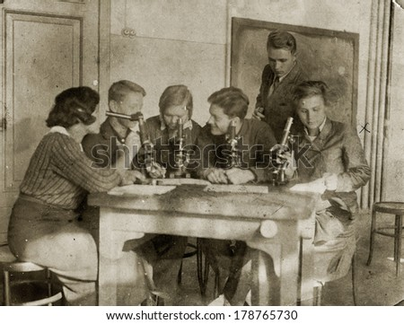 "MOSCOW, USSR - CIRCA 1920s students-biologists conduct a scientific experiment.: An antique photo shows . ""Soviet people"" series."