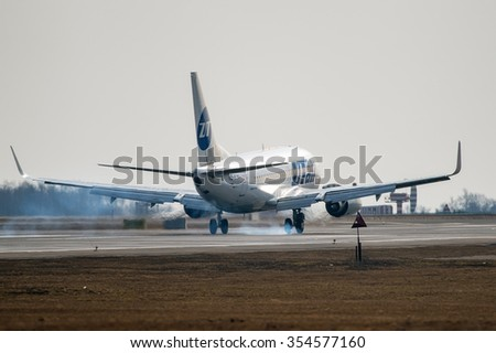 Moscow - Vnukovo, Russia - March 22, 2014: Boeing 737 UTair aviation VQ-BJN  landing at the Moscow Vnukovo International airport.