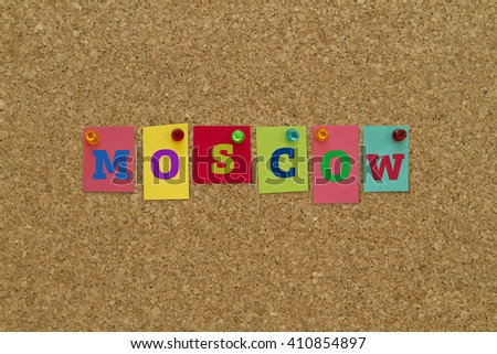 Moscow written on colorful notes pinned on cork board.