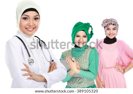 moslem medical doctor wearing scarf. patient at the background - stock photo
