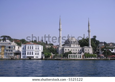 mosque and houses on the bosphorus, istanbul, turkey - stock photo