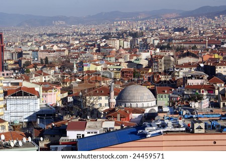 Mosque and many houses in Bursa, Turkey