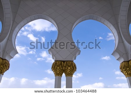 Mosque arch against blue sky - stock photo
