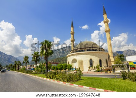 Mosque in Kemer on the backdrop of the mountains, Turkey - stock photo