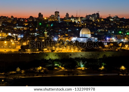Mosque of Caliph Omar (dome of the rock ) in Jerusalem at sunset. View from the mount of Olives. - stock photo