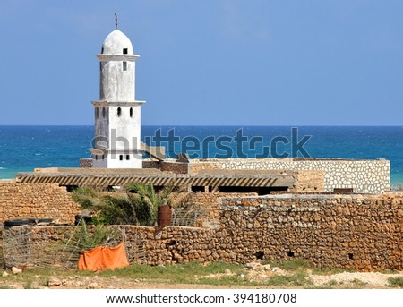 Mosque on Socotra island (Yemen) with turquoise sea background  - stock photo