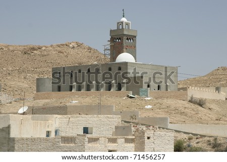 Mosque with Arab style minaret in the desert oasis in Tunisa