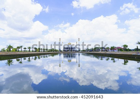 mosque with blue sky and clouds reflection water,select focus with shallow depth of field.