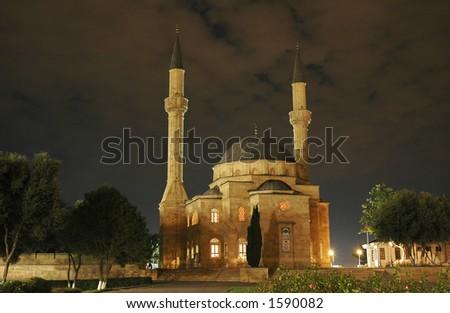 Mosque with two minarets at night in Baku, Azerbaijan - stock photo