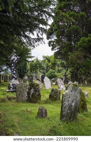 Moss-covered gravestones. Glendalough, Wicklow park, Ireland  - stock photo