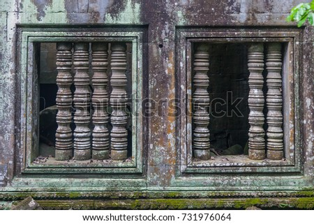 Moss covered rock and window at Ancient Beng Mealea temple World Heritage in Siem Reap,Cambodia.