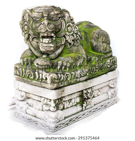 Moss-covered stone lion head. - stock photo