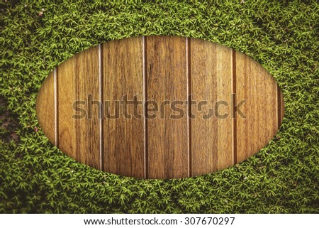 moss oval border on wood