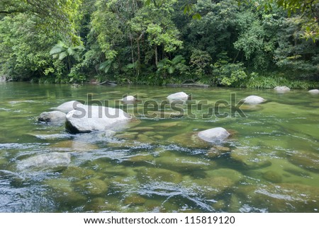 Mossman River floating through Daintree Rainforest near Cairns in Queensland, Australia - stock photo
