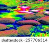 Mossy stones in mountain river in infrared photo. Amazing thermography. Boulders and water level in shadows of trees. - stock photo