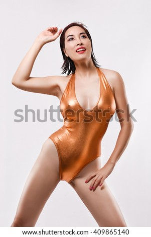 Most beautiful sexy hot Asian woman sexy posing wearing copper one piece bikini isolated in White background - stock photo