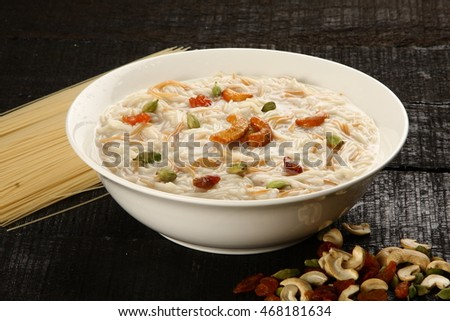Most famous Indian sweet pudding Kheer in a white bowl.Selective focus photograph,