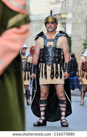 MOSTA, MALTA - APR 22 :Roman centurion during in the Good Friday procession in the village of Mosta in Malta April 22, 2011 - stock photo