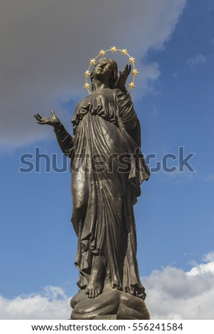 Mosta, Malta - November 12th, 2016. Statue of St. Mary outside the Parish Church of the Assumption at Mosta on Malta with her head raised to the overhead dark clouds.