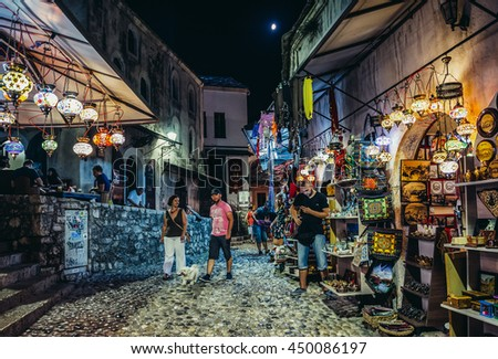 Mostar, Bosnia and Herzegovina - August 25, 2015. Paople walks among souvenirs shops on the Old Town of Mostar