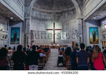 Mostar, Bosnia and Herzegovina - August 25, 2015. People takes part in the Mass in St Peter and Paul Franciscan Church - stock photo