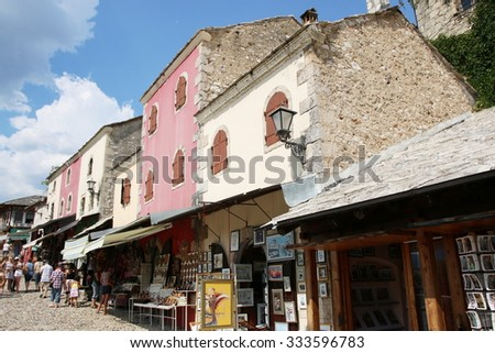 MOSTAR, BOSNIA AND HERZEGOVINA - AUGUST 5 , 2015 : Street in the old town of Mostar with unidentified tourists, the city with a famous old bridge , Bosnia and Herzegovina
