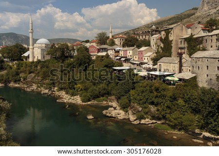 MOSTAR, BOSNIA AND HERZEGOVINA - AUGUST 05, 2015: Tourist and locals walking near Old bridge in Mostar. Included to the UNESCO heritage