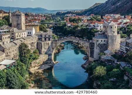 Mostar, Bosnia and Herzegovina - August 25, 2015. View with Stari Most (english: Old Bridge), reconstructed 16th century Ottoman bridge, main attraction of Mostar Old Town - stock photo