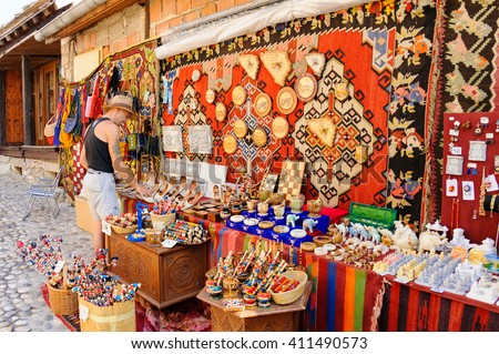 MOSTAR, BOSNIA AND HERZEGOVINA - SEPTEMBER 1, 2009: Old town east side street vendor