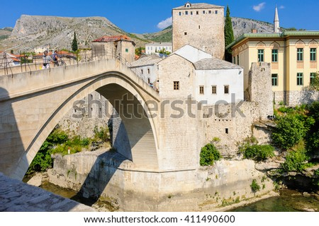 MOSTAR, BOSNIA AND HERZEGOVINA - SEPTEMBER 1, 2009: The new Stari Most (old bridge) reconstructed from local tenelia stone.