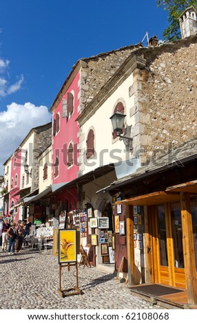 MOSTAR, BOSNIA AND HERZEGOVINA- SEPTEMBER 24: Tourists Perusing the Colorful Shops in the Old Town On September 24, 2010 in Mostar, Bosnia and Herzegovina - stock photo